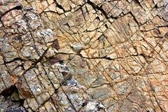 Gebarsten oppervlakte van klippengezicht Stock Afbeelding
