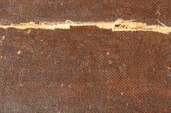Gebarsten structuur, bruine textiel en houten achtergrond Stock Foto