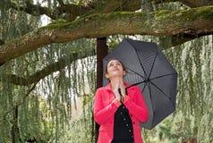 Gebed in de regen Stock Afbeelding