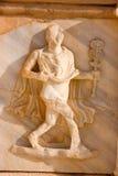 Gebeeldhouwd fries met de één mens, Sabratah - Libië Stock Afbeeldingen