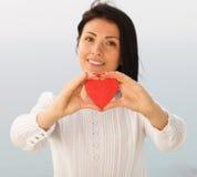 Geben des Herzens lizenzfreie stockbilder