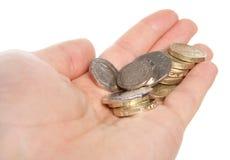 Geben des Kleingeldes Stockfotos