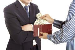 Geben eines Bestechungsgeldes Lizenzfreie Stockfotos