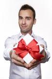 Geben eines Geschenks Stockbilder