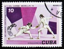 geben Sie den Stempel bekannt, der in Kuba gedruckt wird, fechtenden Shows, die circa 1978 Stockfotos