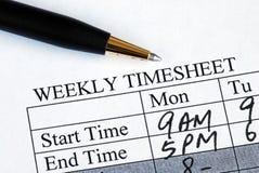 Geben Sie den wöchentlichen Stundenzettel ein Stockbild