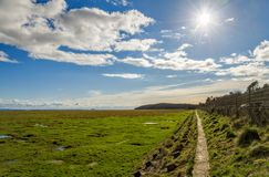 Gebieden langs kust, landhuis-over--Zand, Cumbria, Engeland Stock Fotografie