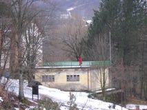 Gebirgshaus im Winter Stockbild