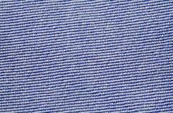 Gebissen vom blauen Baumwollstoff Lizenzfreie Stockbilder