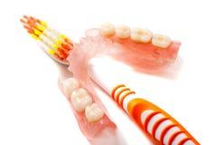 Gebit en tandenborstel Stock Foto's