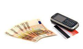 Gebläse der Banknoten von Euro und von Telefon Stockbilder