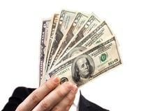 Gebläse des Geldes in den Händen Stockbild