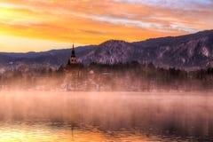 Geblutet mit See im Winter, Slowenien, Europa Stockfotografie