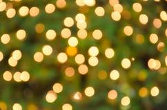 Geboekte Lichte gouden onscherpe achtergrond Stock Foto
