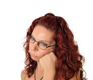 Gebohrte Frau, die sehr frustriert schaut Stockfotografie