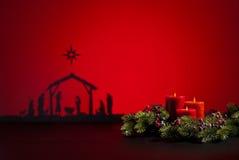 Geboorte Jesus en kaarsen stock foto