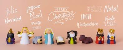 Geboorte van Christusscène en tekst vrolijke Kerstmis royalty-vrije illustratie