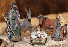 Geboorte van Christusscène met Jesus, Joseph en Mary in een trog op Christus Stock Foto