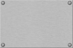 Geborstelde metaalplaat met schroeven Stock Afbeeldingen