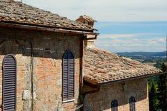 Gebouwen in de stad van San Gimignano in Toscanië, Italië Stock Foto