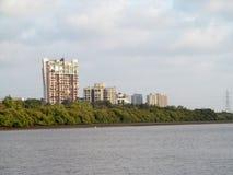 Gebouwen op de kust Stock Foto's
