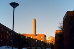 Gebouwen in Zweedse Stad door Zonsondergang stock fotografie