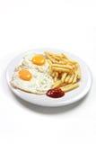 Gebraden eieren met gebraden gerechten Stock Afbeelding
