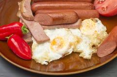Gebraden eieren met worst Royalty-vrije Stock Afbeelding