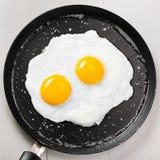 Gebraden eieren op een pan Royalty-vrije Stock Afbeelding