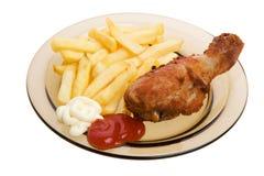 Gebraden kip en frieten Royalty-vrije Stock Afbeeldingen