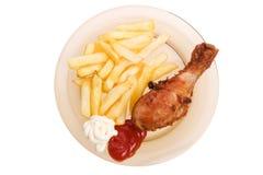 Gebraden kip en frieten Stock Foto