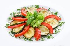 Gebraden pompoenen met groen en tomaten stock afbeelding