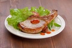 Gebraden varkensvleeskotelet Stock Afbeelding