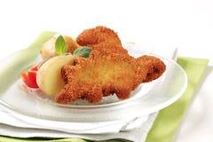 Gebraden vissen en aardappels Royalty-vrije Stock Foto's