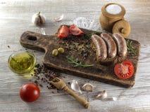 Gebraden worsten met olijfolie Stock Afbeeldingen