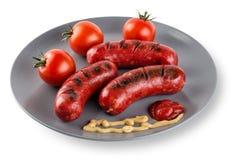 Gebraden worsten met tomatenmosterd en ketchup op plaat Royalty-vrije Stock Foto's