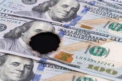 100 gebrande dollarrekening Stock Foto's