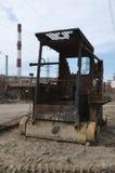 Gebrande tractor Stock Foto's