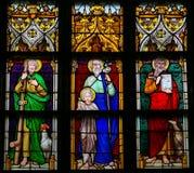Gebrandschilderd glas - Heilige Peter, Saint Joseph en Heilige John Eva Stock Fotografie