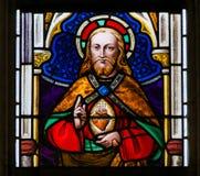 Gebrandschilderd glas - Jesus Christ en het Heilige Hart stock foto's