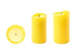 Gebrannte gelbe Wachskerze Stockfotos