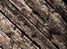 Gebrannte hölzerne Planken im Sonnenlicht Stockbilder
