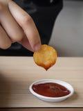 Gebratene Bratkartoffel des Frühstücks der ungesunden Fertigkost amerikanische Kartoffel ungesund Lizenzfreie Stockfotografie