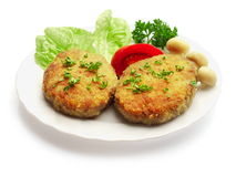 Gebratene Fleischklöschen verziert mit Pilzen Lizenzfreies Stockbild