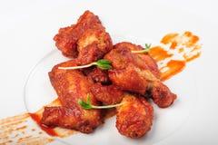 Gebratene Hühnerbeine in der roten Karamellsoße Lizenzfreie Stockfotografie
