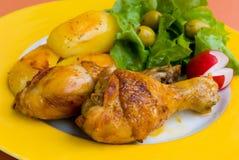Gebratene Hühnerbeine mit pota Lizenzfreie Stockbilder