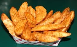 Gebratene Kartoffel-Keile Lizenzfreie Stockfotos
