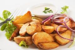 Gebratene Kartoffelkeile Stockfotos