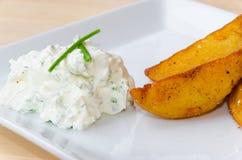 Gebratene Kartoffeln mit sahnigem Bad Lizenzfreies Stockbild