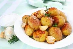 Gebratene Knoblauch-Kartoffeln Lizenzfreie Stockfotos